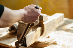 Worker securing a detail in a vise. Worker securing a detail in a rusty vise Stock Images