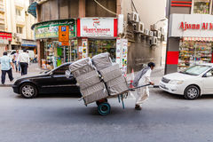 Worker send Goods by Trolley in The Souk of Dubai.  Royalty Free Stock Image