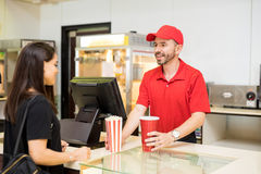 Worker serving food at a concession stand Stock Images