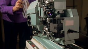 Worker set up antique Film Projector. stock video