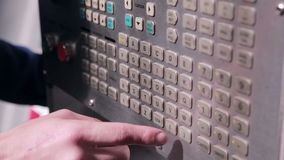 The worker sets the parameters on robotic automsted industrial Machine stock footage