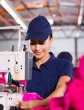 Worker sewing garment Stock Photos