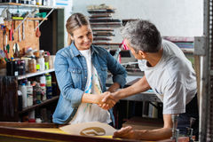 Worker Shaking Hands With Colleague In Factory Royalty Free Stock Photography