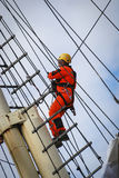 Worker on a ship mast Royalty Free Stock Image