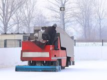 A worker is shooting a special ice maintenant machine at a sports rink. Cooking place for skating. ice preparation at the rink royalty free stock photos