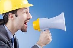 Worker shouting via loudspeaker. Construction worker shouting via loudspeaker Royalty Free Stock Image