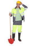 Worker with a shovel Stock Photography