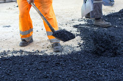 Worker with shovel on asphalt Royalty Free Stock Images