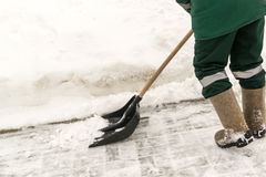 Worker Shovelling Snow Stock Images
