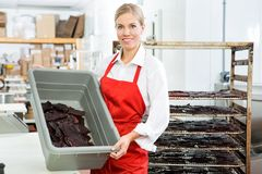 Worker Showing Beef Jerky In Basket At Shop Stock Photo