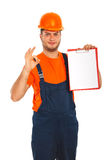 Worker showing blank clipboard Royalty Free Stock Images