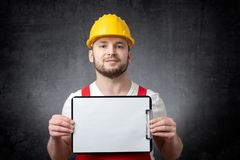 Worker showing blank clipboard royalty free stock photos