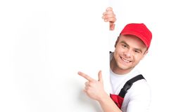 Worker showing blank sign and smiling. Royalty Free Stock Images