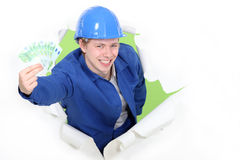 Worker showing cash. Royalty Free Stock Photography
