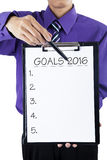 Worker showing clipboard with goals for 2016 Royalty Free Stock Photography