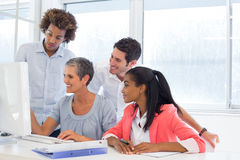 Worker showing colleagues her progress Stock Photo