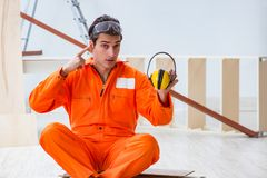 Worker showing the importnace of wearing noise cancelling headph. Ones stock photo