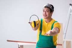 Worker showing the importnace of wearing noise cancelling headph. Ones royalty free stock images