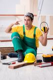 Worker showing the importnace of wearing noise cancelling headph royalty free stock photography