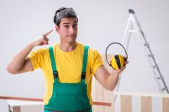 Worker showing the importnace of wearing noise cancelling headph royalty free stock photos