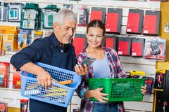 Worker Showing Product To Customer In Hardware Stock Image