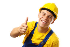 Worker showing thumb up sign Stock Photo