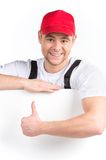 Worker showing thumb up sign and smiling. Royalty Free Stock Image