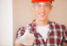 Worker showing thumb up stock photos