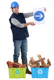 Worker showing the way to recycling. Stock Images