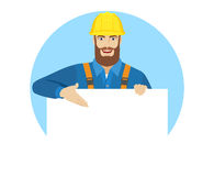 Worker showing white blank poster Stock Photos