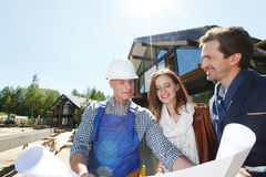 Worker shows construction plan Royalty Free Stock Image