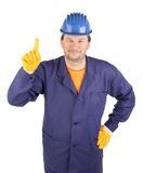 Worker shows hand attracting attention. Royalty Free Stock Photo