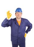 Worker shows hand sign okey. Isolated on a white backgropund Stock Image