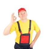 Worker shows hand sign okey Royalty Free Stock Images
