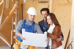 Worker shows house design plans Stock Images
