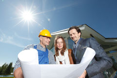 Worker shows house design plans Stock Photography