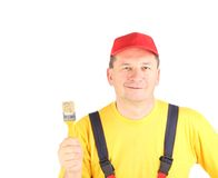 Worker shows painting brush. Royalty Free Stock Images