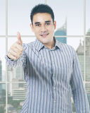 Worker shows thumb up near the window Royalty Free Stock Photography