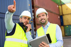Worker shows to supervisor security system setting up Stock Images