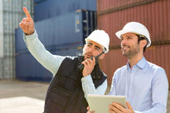 Worker shows to supervisor security system setting up Royalty Free Stock Image