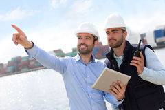 Worker shows to supervisor security system setting up Royalty Free Stock Photos