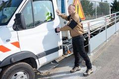 Worker shutting cab door vehicle. Worker shutting cab door of vehicle royalty free stock image