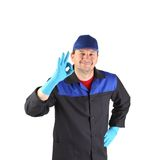 Worker with sign okey. Isolated on a white background Royalty Free Stock Photography