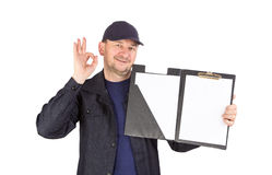 Worker with sign okey. Isolated on a white background Royalty Free Stock Photo