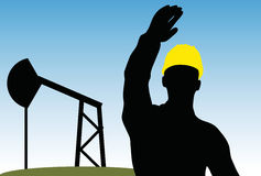 Worker silhouette with yellow protective headgear Royalty Free Stock Photo