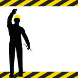 Worker silhouette with yellow protective headgear Stock Photo