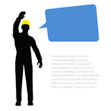 Worker silhouette with yellow protective headgear Stock Image