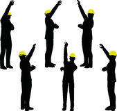 Worker silhouette with yellow protective headgear Royalty Free Stock Images