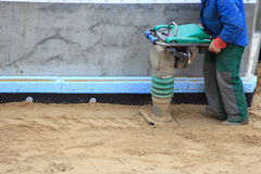 Worker at site working with compress tool Stock Image