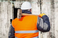 Worker with sledge hammer against the wall Stock Photos